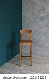 Wooden chair on gray wall background. minimalistic concept. Interior design.