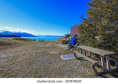 Wooden chair on the hill at Pukaki Lake view point, New Zealand