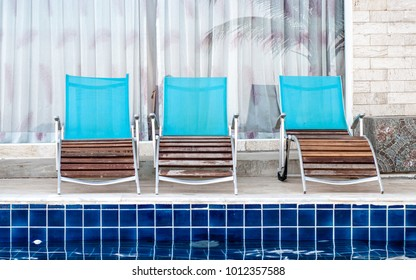 Wooden chair on the pool