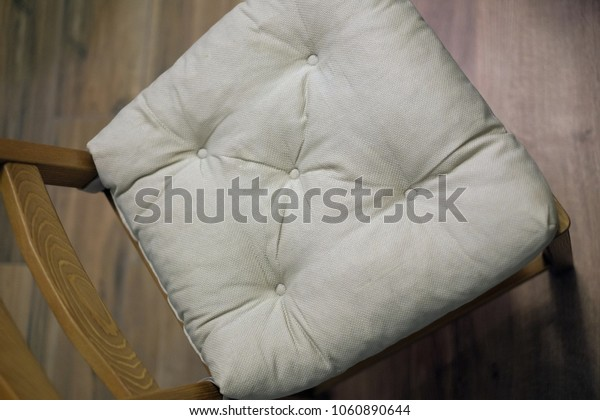 Wooden chair with a soft seat
