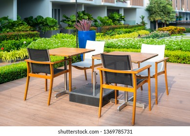Wooden chair in wood patio at green garden in house