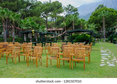 wooden chairs arranged as a cinema hall outdoors at a hotel in Turkey