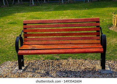 Wooden chairs on the grass in the outdoor park