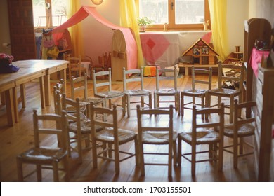 Wooden chairs placed in a circle at Waldorf school.