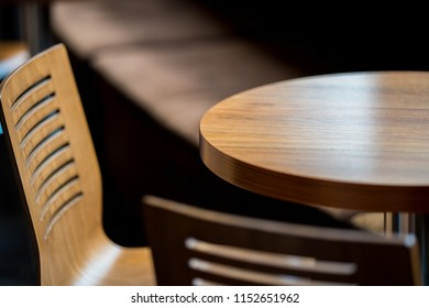 Wooden chairs and round table