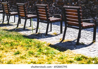 Wooden chairs in a row in Sibiu, Romania