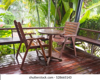 wooden chairs and table in pavilion