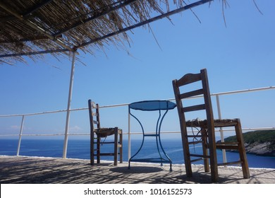 Wooden chairs and table terrace with ocean view