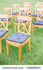 wooden chairs for the wedding ceremony stand on the green grass