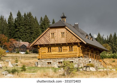Wooden chalet in the autumn sunshine, the wooden house