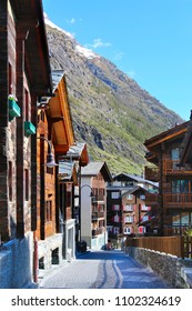 Wooden chalet in the city of Zermatt, Switzerland. The streets in Zermatt. Cottages in the mountains.