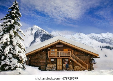 wooden chalet  in the french alps in winter with with a beautiful blue sky and  snow annecy france switzerland stadt