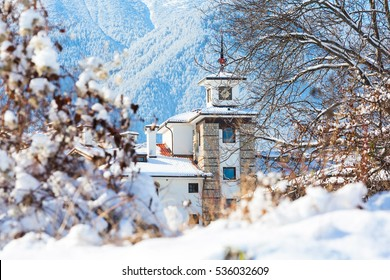 Wooden chalet with tower and snow mountains panorama in bulgarian ski resort Bansko, Bulgaria