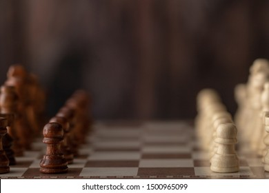 wooden chess endways on the board with wood background. Select focus shallow depth of field.