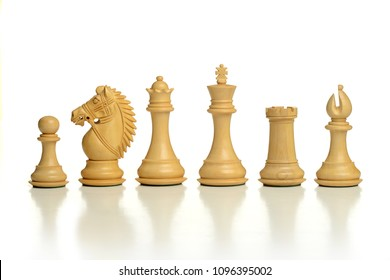 Wooden chess pieces isolated on a white background