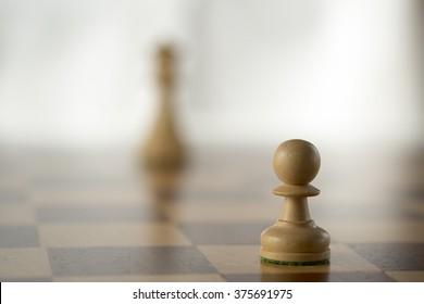 wooden chess set, white pawn wants to be white queen