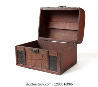 Wooden chest with forging and leather straps on white background