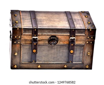 Wooden chest with ornamental forging and leather straps isolated on white background