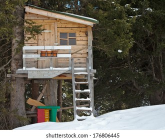 Wooden child tree house in snow
