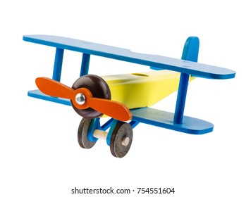 Wooden children's colored airplane, red propeller, blue wings isolated on white background.