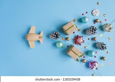 wooden children's plane on a blue background