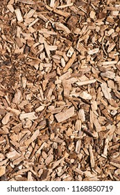 Wooden chips background close up. Used as an organic mulch in gardening, landscaping, restoration ecology, bioreactors for denitrification and as a substrate for mushroom cultivation.