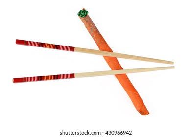 Wooden chopsticks on white background
