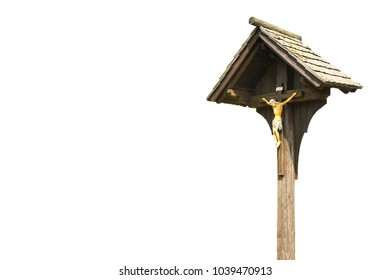 Wooden christian cross against a white background for easy selection - image with copy space