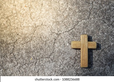 Wooden Christian cross with concrete background. Wooden Christian cross background. Christianity Concept. Faith hope love concept.