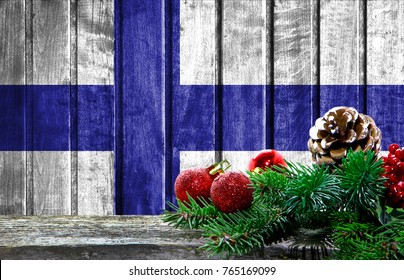 Wooden Christmas background with a flag of Finland. There is a place for your text in the photo.