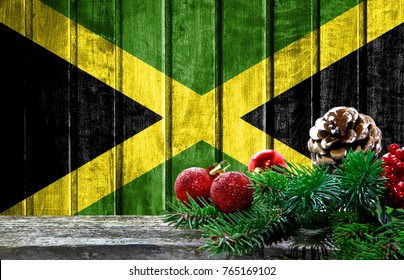 Wooden Christmas background with a flag of Jamaica. There is a place for your text in the photo.