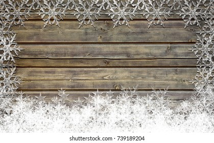 Wooden Christmas background with snow flakes