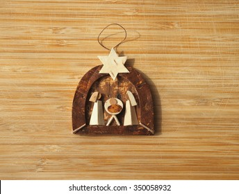 Wooden christmas creche on a wooden background
