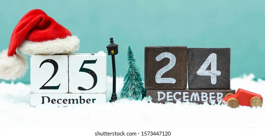 wooden christmas date with holiday background
