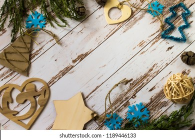 wooden christmas decorations in rustic style on the wooden light table with cypres branches