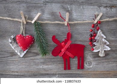 Wooden christmas deer and decoration on wooden background