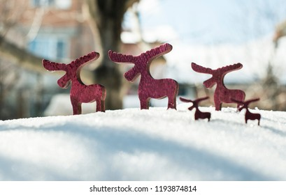 Wooden Christmas deer shape on snow.