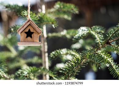 Wooden Christmas house on tree