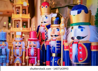 Wooden Christmas toys and decorations at Christmas market at Germany in Europe in winter. German street Xmas fair with wood nutcrackers in European city or town. Berlin on Alexanderplatz