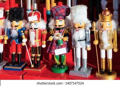 Wooden Christmas toys and decorations on Christmas market at Germany in Europe in winter. German street Xmas fair with wood nutcrackers in European city or town. Berlin in Alexanderplatz