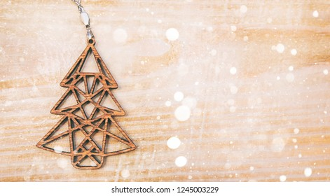 Wooden christmas tree on the wooden table