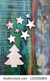 Wooden Christmas tree with wooden stars on a table