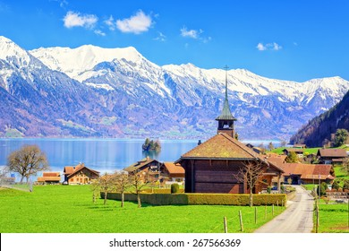 Wooden church with alpine lake landscape in background, Bern, Switzerland