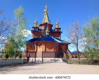 The wooden church with golden domes