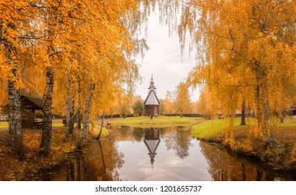 A wooden church in the museum of wooden architecture in Kostroma, Russia. Amazing autumn landscape.