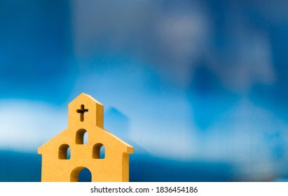 Wooden Church on blue background.Christianity, Catholic, Cross and Jesus christ.Worship and Praise in Church.Community for relationship with Believer to GOD and each other.Church design background.