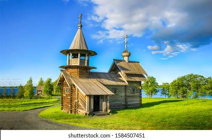 Wooden church on summer rural landscape. Wooden church. Church in village. Rural wooden church