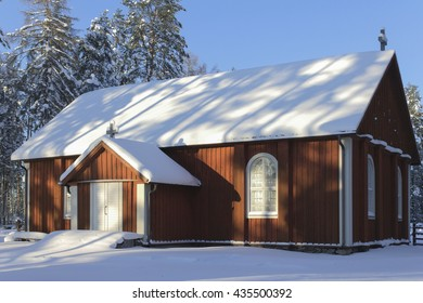 Wooden church Wooden church in wintry countryside in Finland.