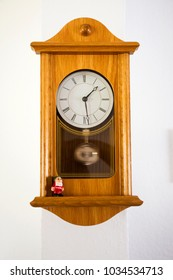Wooden Classic clock germany style on wall in house