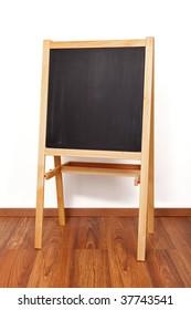 Wooden, clear blackboard in empty classroom